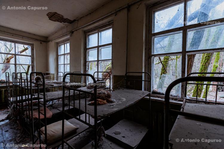 Dormitory of an abandoned school near Prypiat, Chernobyl area - Ukraine, 2019