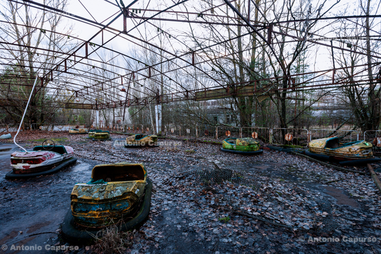 Abandoned bumper cars in the ghost town of Prypiat, Chernobyl area - Ukraine, 2019