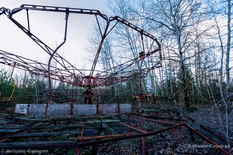 Abandoned carousel in the ghost town of Prypiat, Chernobyl area - Ukraine, 2019