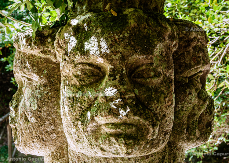 Statue of Hecate, ancient Greek goddess, often represented with a triple head - Sacred Grove of Bomarzo, Lazio - Italy, 2013
