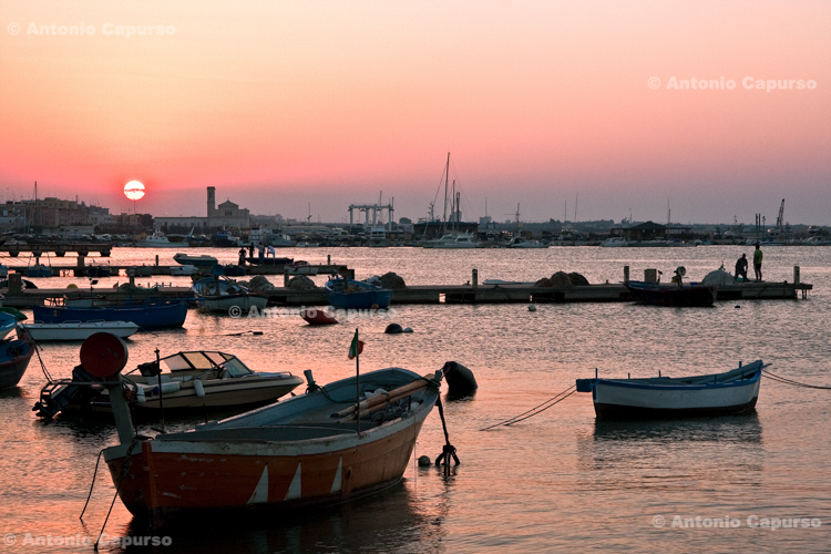 Boats in the harbour at sunset - Molfetta, Italy