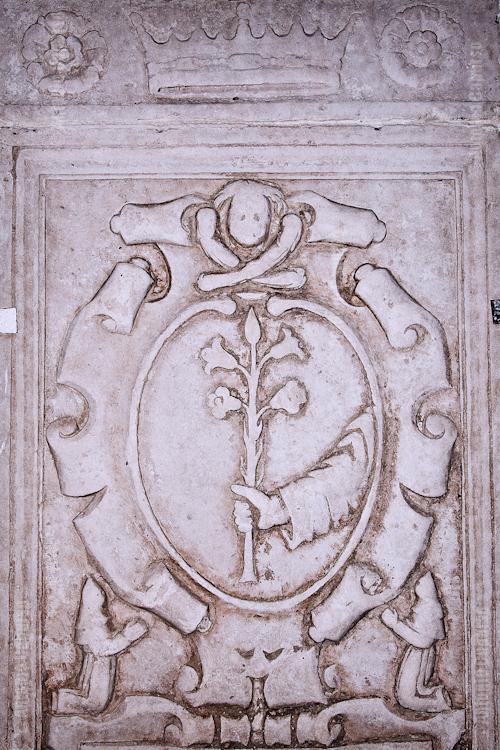 "The Lily is the symbol of the Confraternita di Sant'Antonio di Padova. Each ""confraternita"" (fellowship) has its emblem or motto often carved in stone"