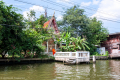 Buddhist temple on a khlong (canal)  in Bangkok - Thailand, 2013